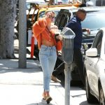 Hailey Baldwin in a Bright Orange Midriff Sweater
