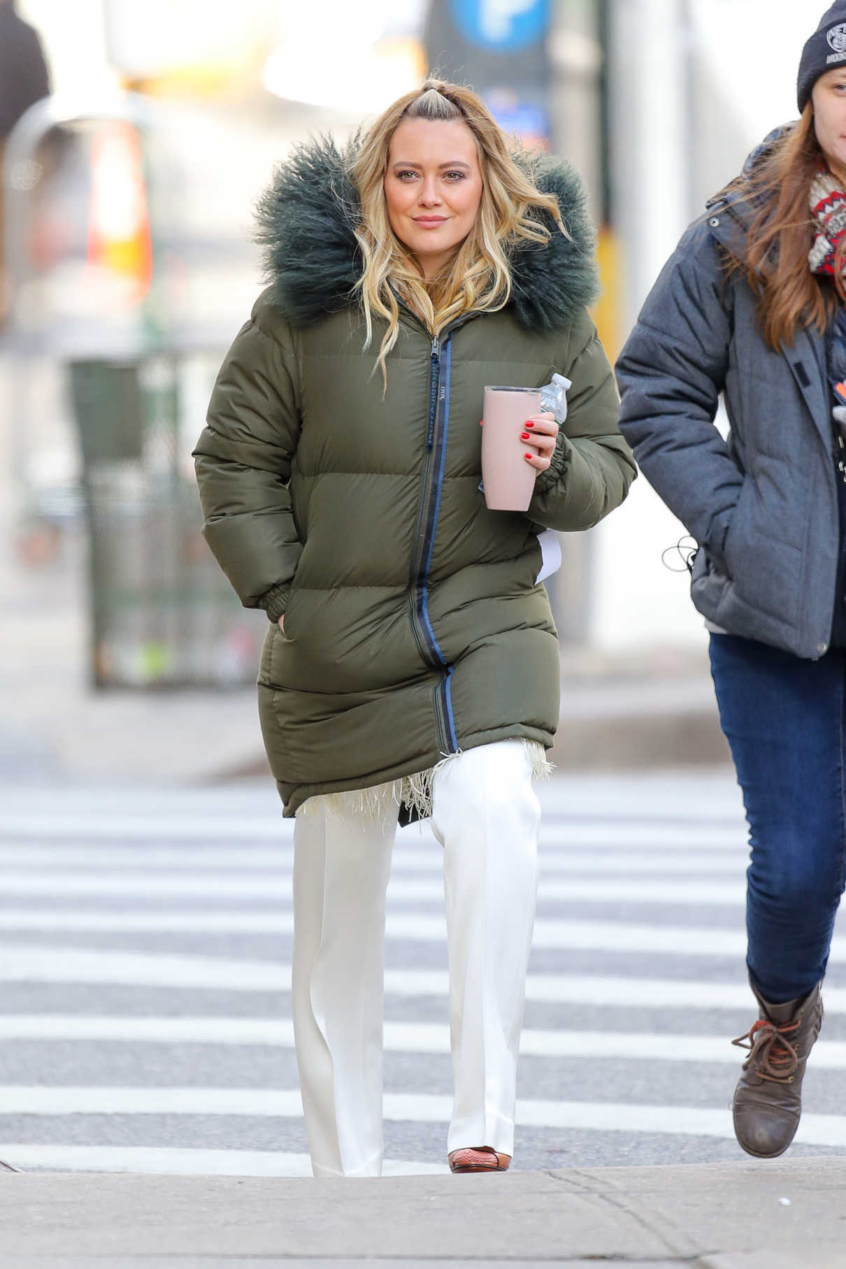 Hilary Duff in a Green Puffer Coat
