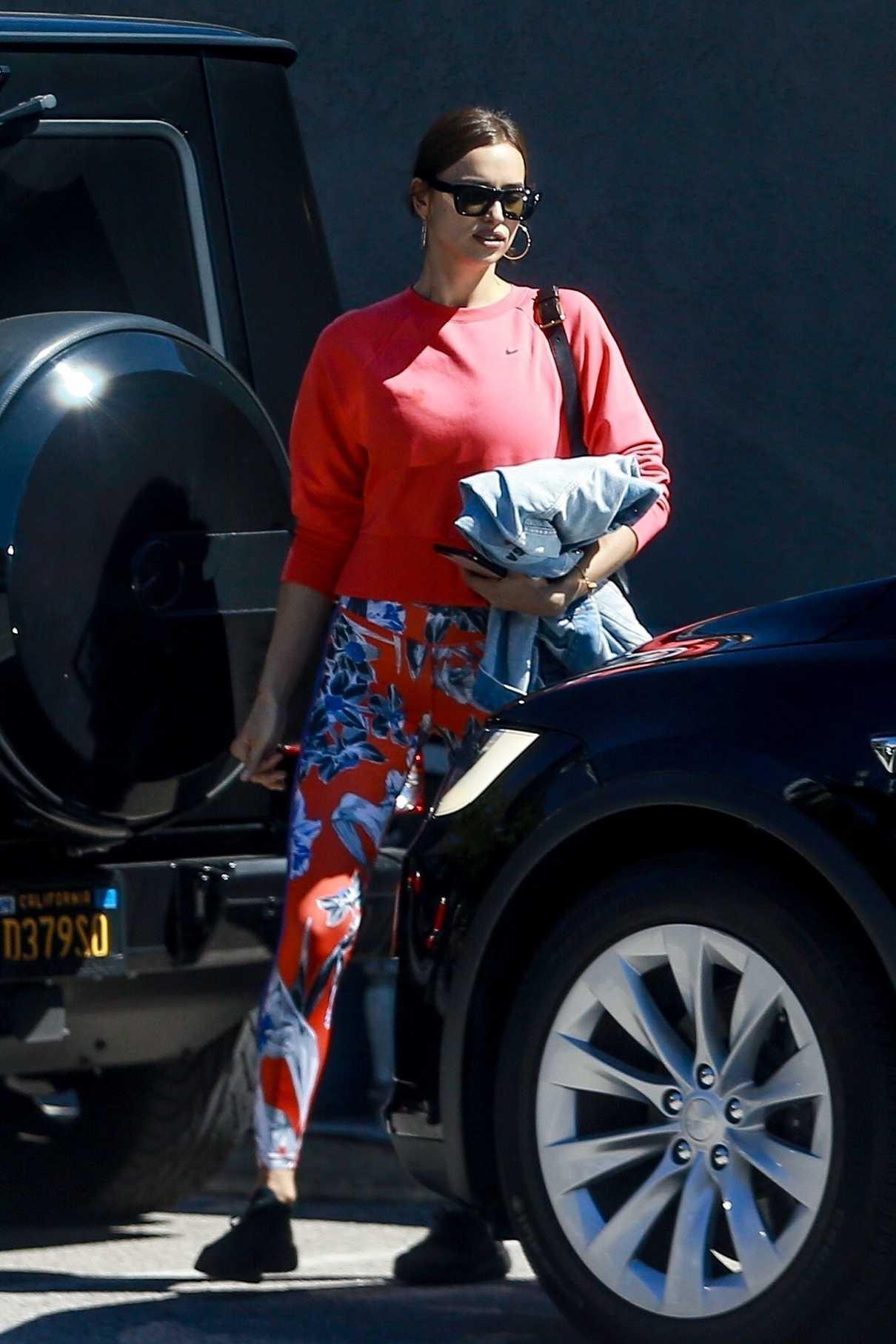Irina Shayk in a Red Nike Sweatshirt