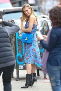 Joy Corrigan in a Blue Floral Sundress