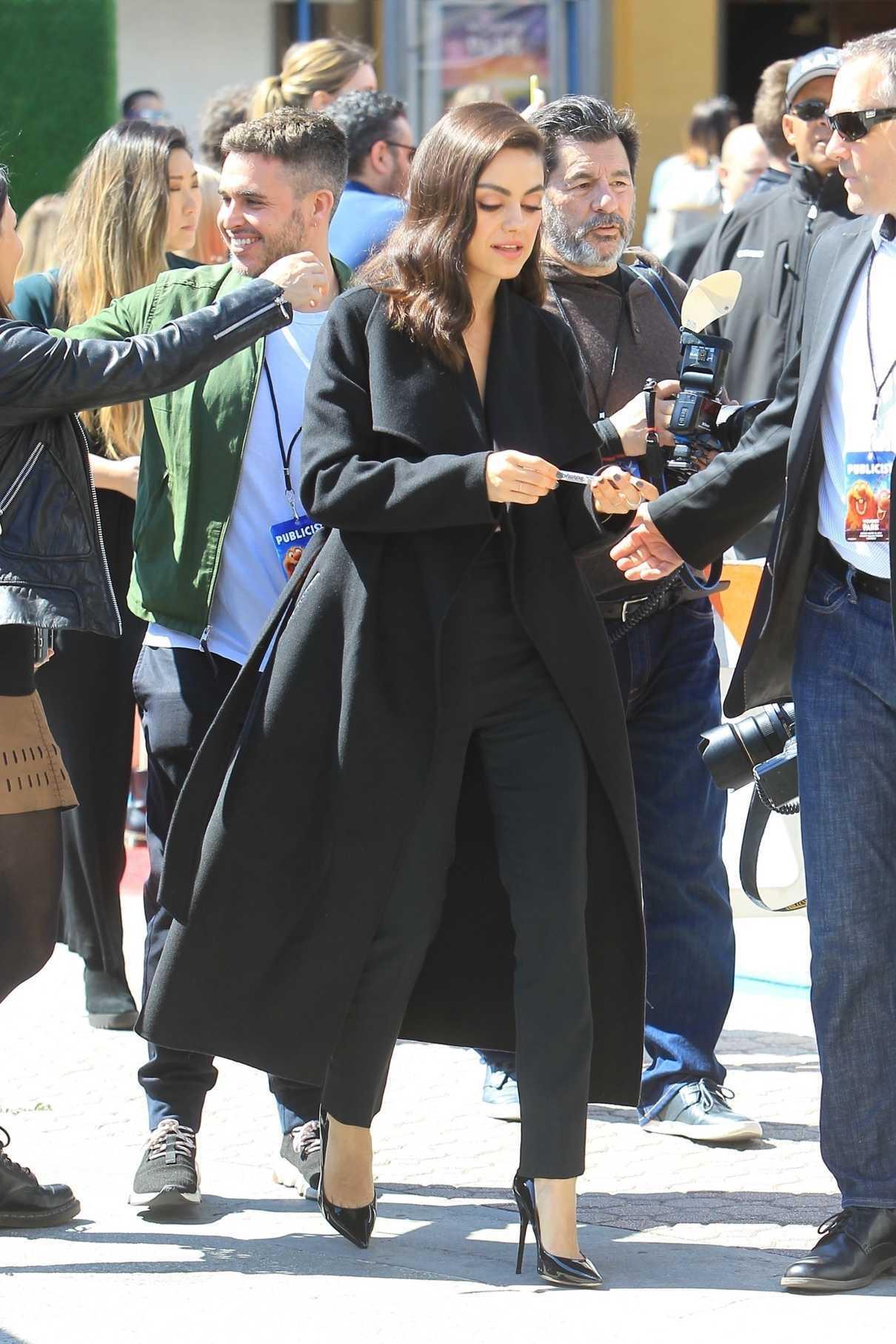 Mila Kunis in a Black Coat