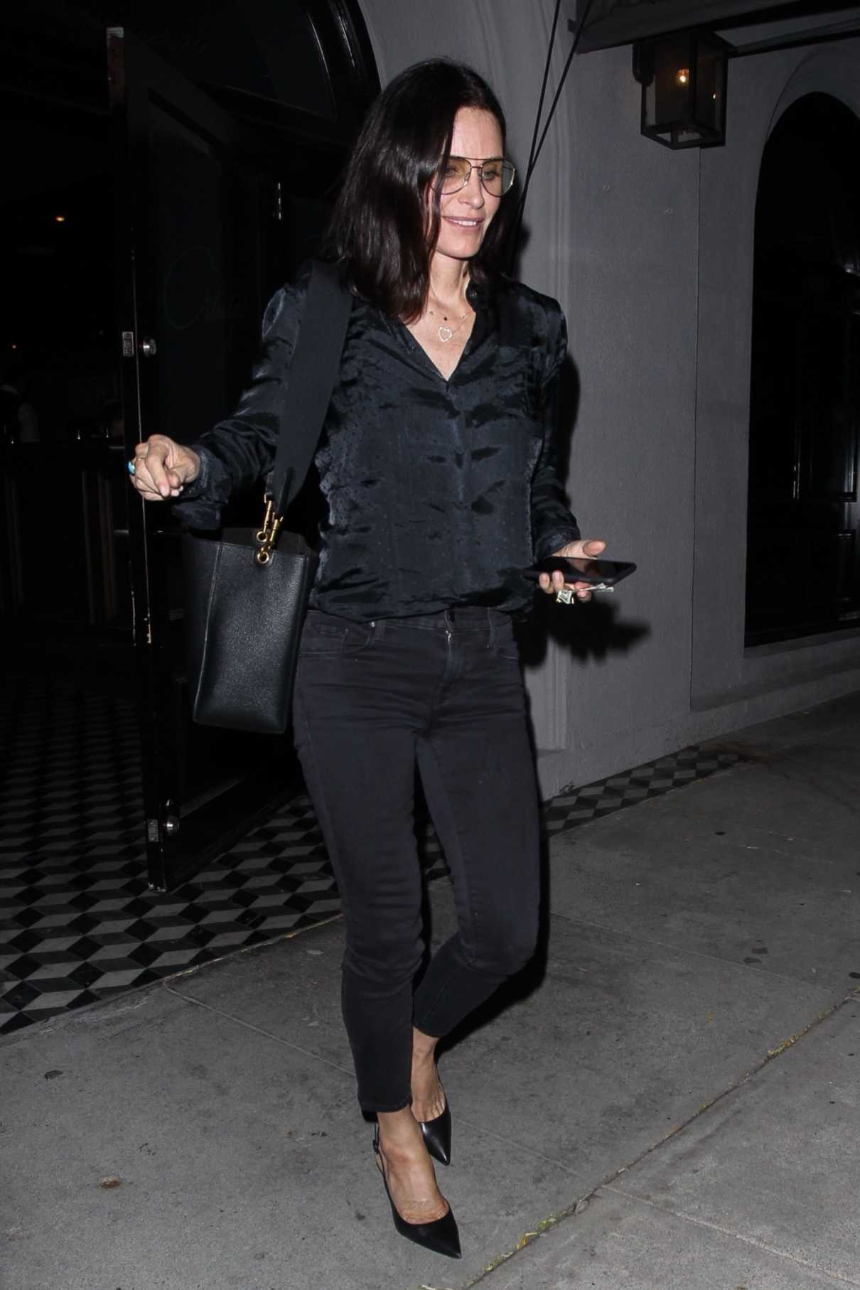 Courteney Cox in a Black Jeans