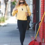 Emma Roberts in a Yellow Hoody