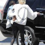 Khloe Kardashian in a White Sweatshirt