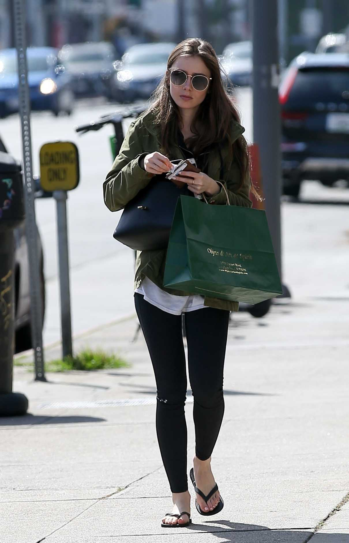 Lily Collins in a Military Green Jacket