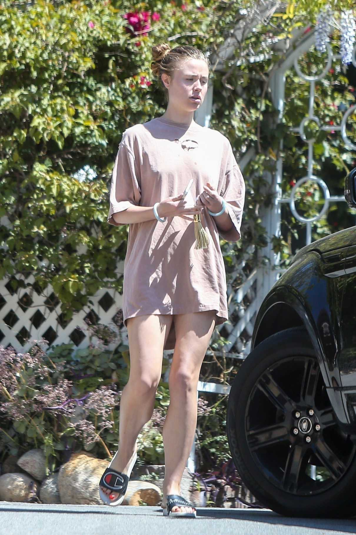 Lucy Fry in a Beige Oversized T-Shirt