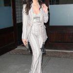 Olivia Munn in a Striped Suit