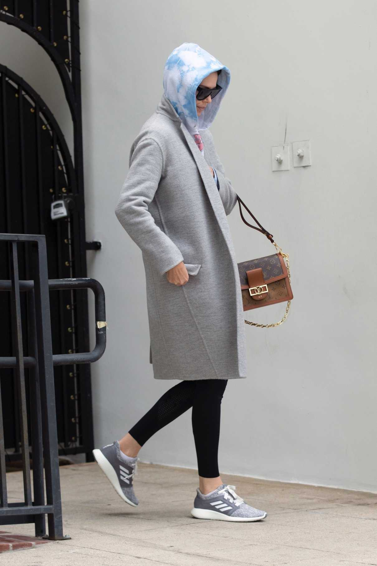 Charlize Theron in a Gray Coat