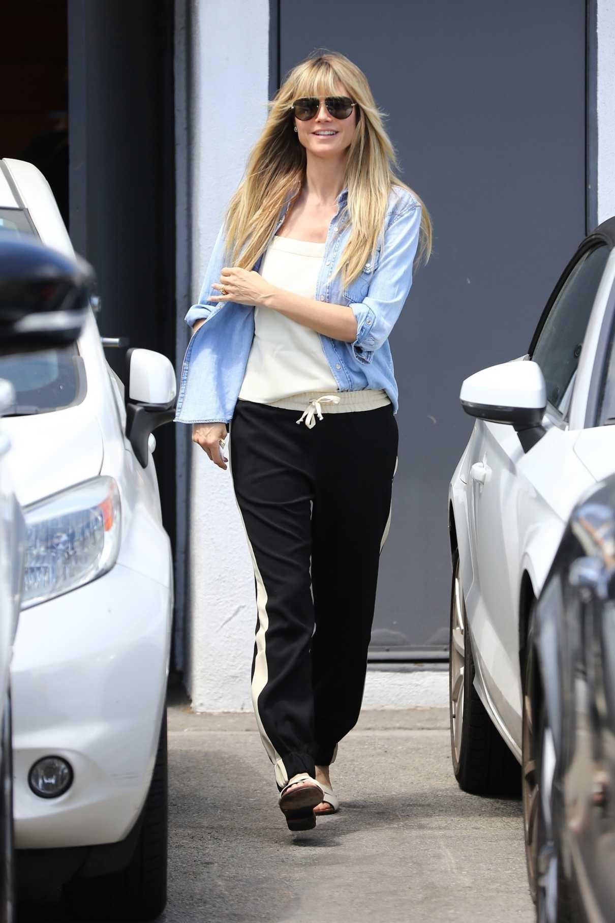 Heidi Klum in a Blue Denin Shirt
