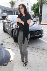 Courteney Cox in a Gray Pants