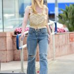 Elle Fanning in a Floral Yellow Blouse