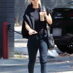 Kaley Cuoco in a Black Tee