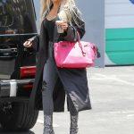 Khloe Kardashian in a Black Trench Coat
