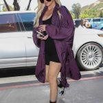 Khloe Kardashian in a Purple Trench Coat