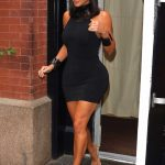 Kim Kardashian in a Black Form Fitting Dress