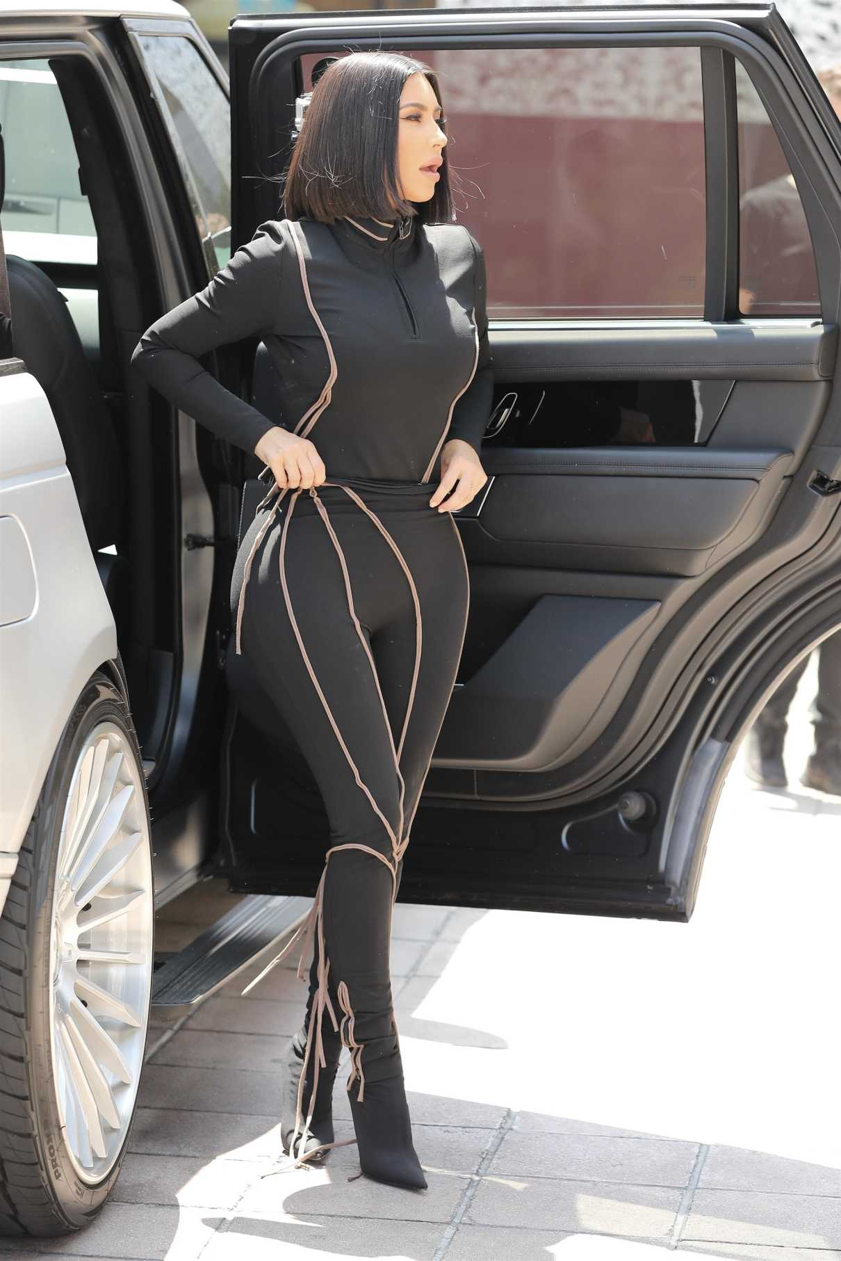 Kim Kardashian in a Black Form Fitting Suit
