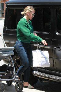Hilary Duff in a Green Sweatshirt