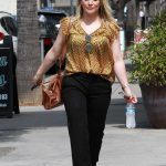 Hilary Duff in a Yellow Blouse
