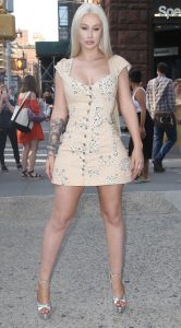 Iggy Azalea in a Beige Dress