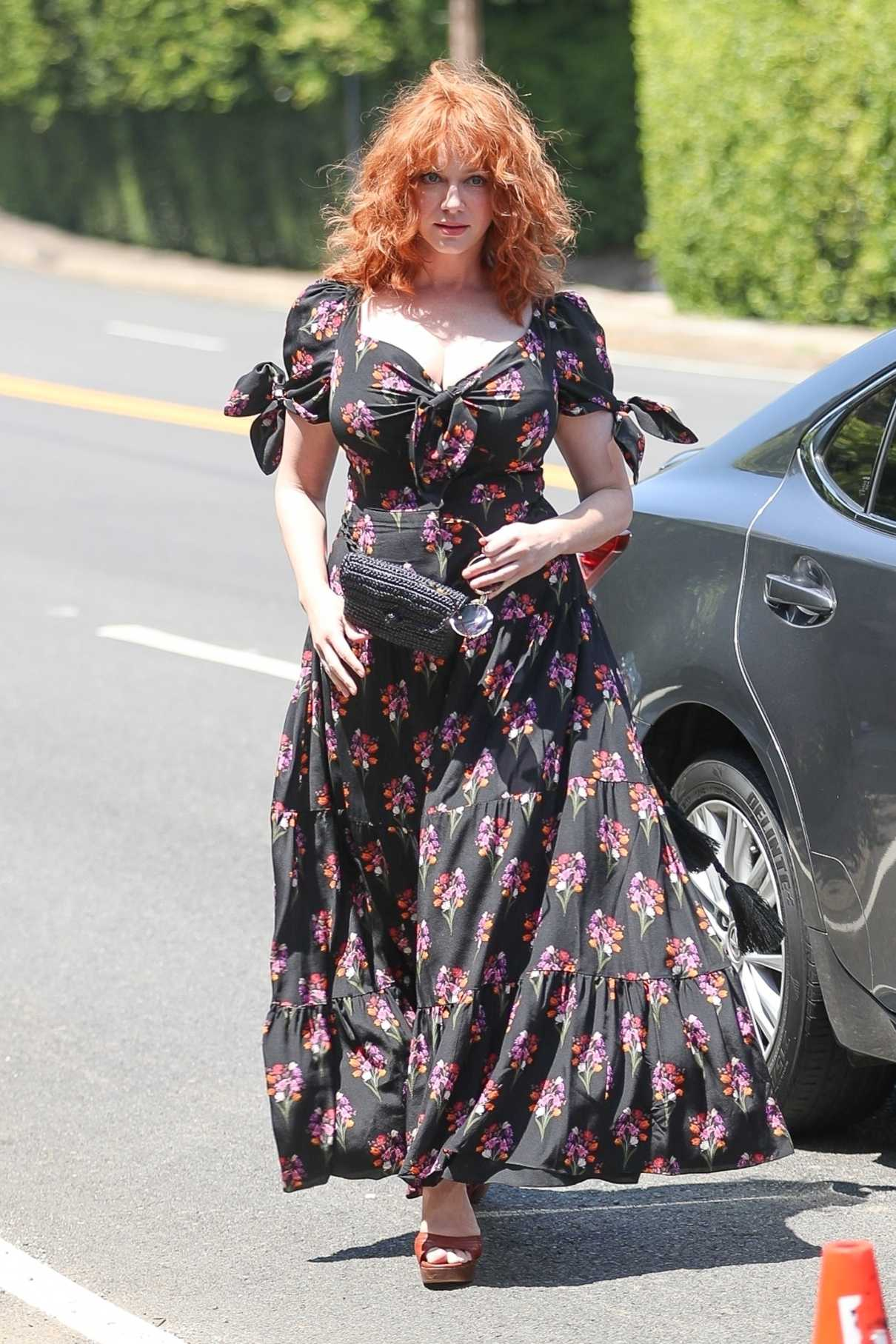 Christina Hendricks in a Black Floral Dress