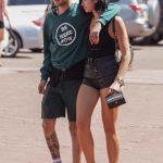 Dua Lipa in a Black Daisy Duke Shorts