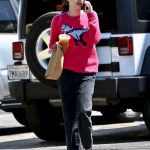 Emma Roberts in a Pink Sweater