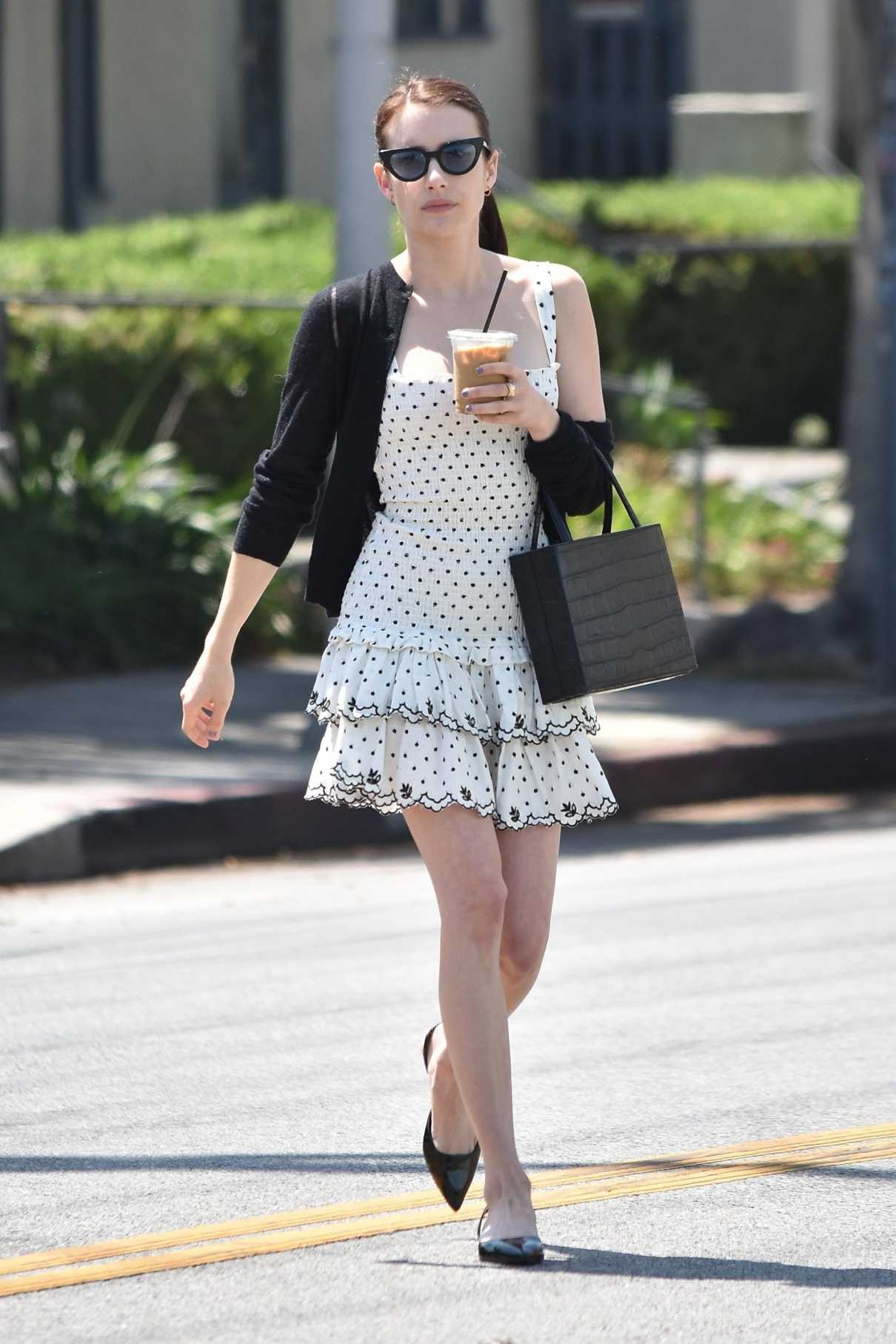 Emma Roberts in a Short White Polka Dot Dress