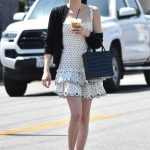 Emma Roberts in a Short White Polka Dot Dress