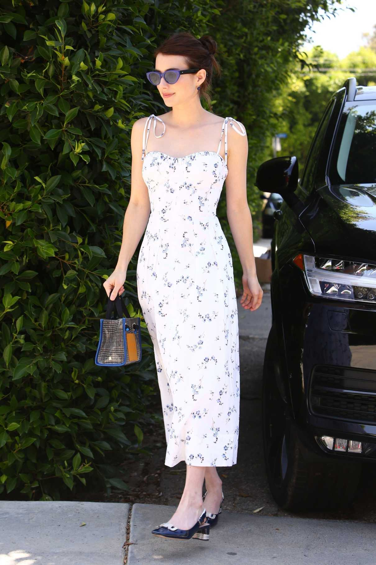 Emma Roberts in a Summery White Floral Dress