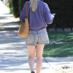 Kirsten Dunst in a Purple Sweatshirt