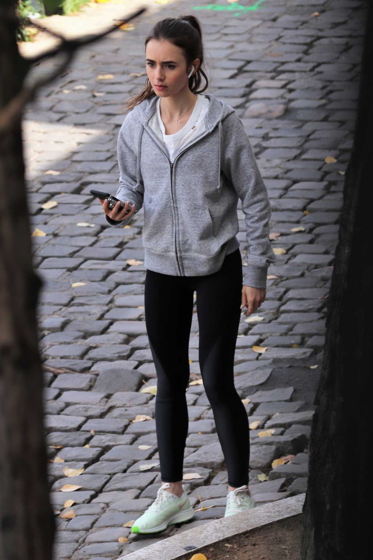 Lily Collins in a Black Leggings