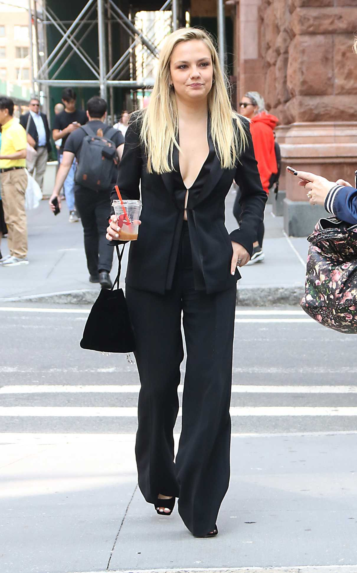 Emily Meade in a Black Suit