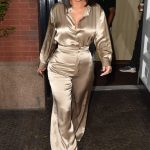 Kim Kardashian in a Gold Suit