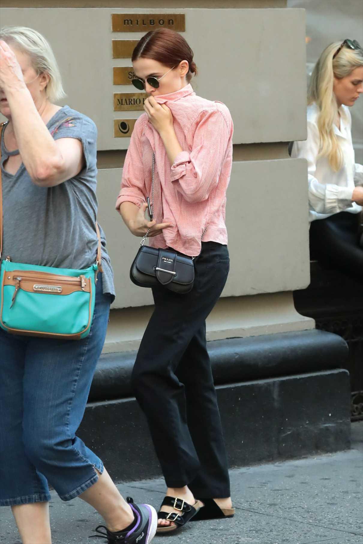 Zoey Deutch in a Pink Shirt