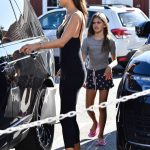 Alessandra Ambrosio in a Black Form Fitting Jumpsuit