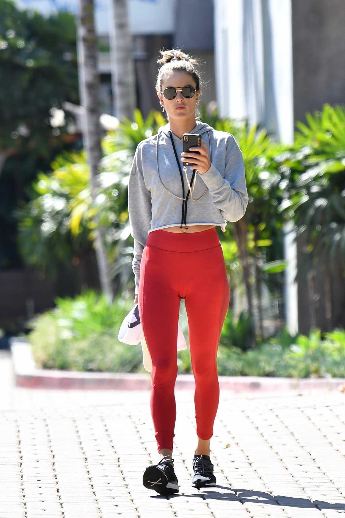 Alessandra Ambrosio in a Red Leggings