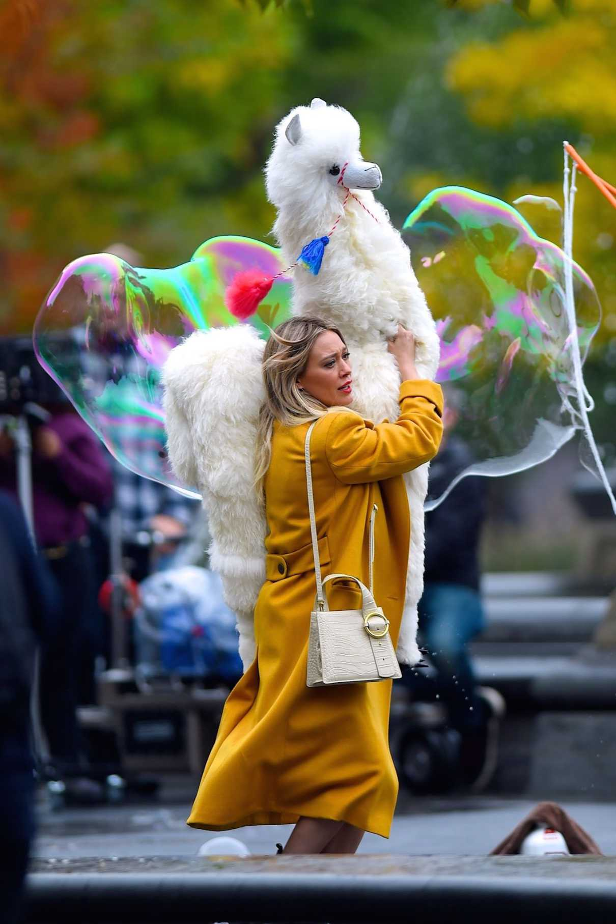 Hilary Duff in a Yellow Coat
