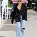 Khloe Kardashian in a Blue Ripped Jeans