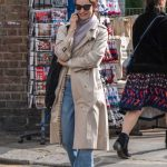 Lily James in a Beige Trench Coat