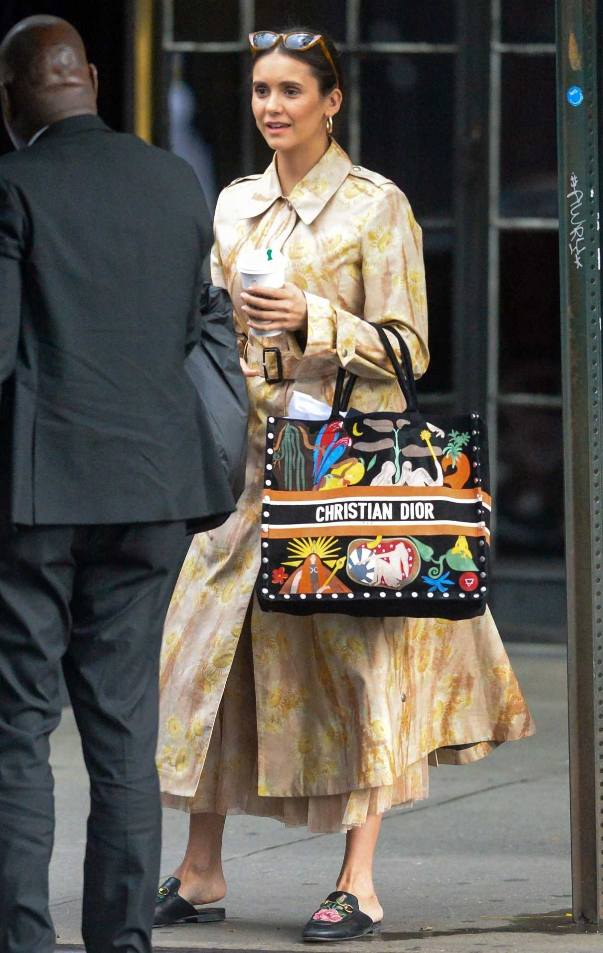 Nina Dobrev in a Beige Floral Trench Coat