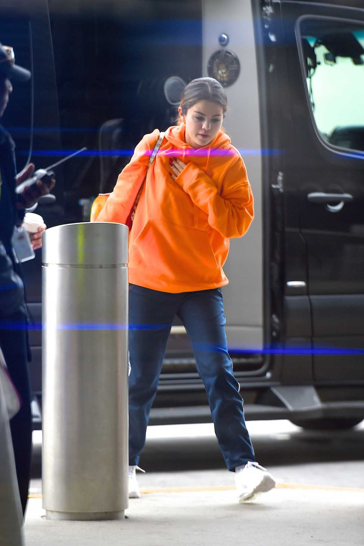 Selena Gomez in an Orange Hoody