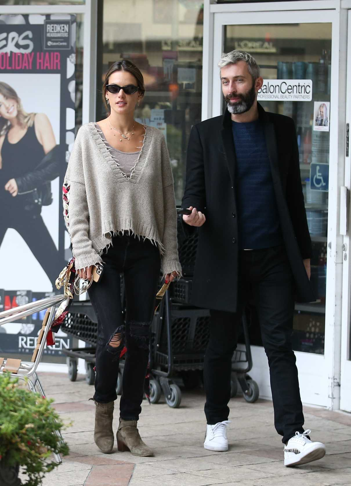 Alessandra Ambrosio in a Black Ripped Jeans