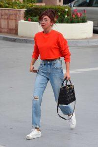 Sarah Hyland in a Red Sweatshirt
