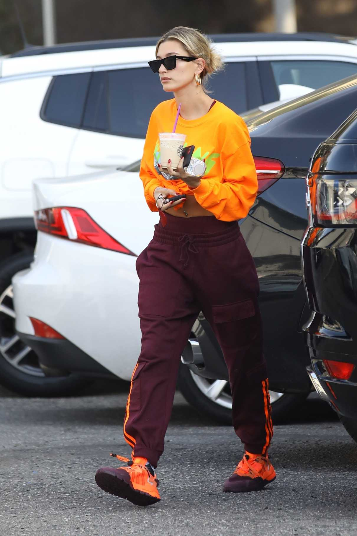 Hailey Bieber in an Orange Sweatshirt