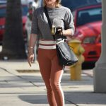 Hilary Duff in an Orange Leggings