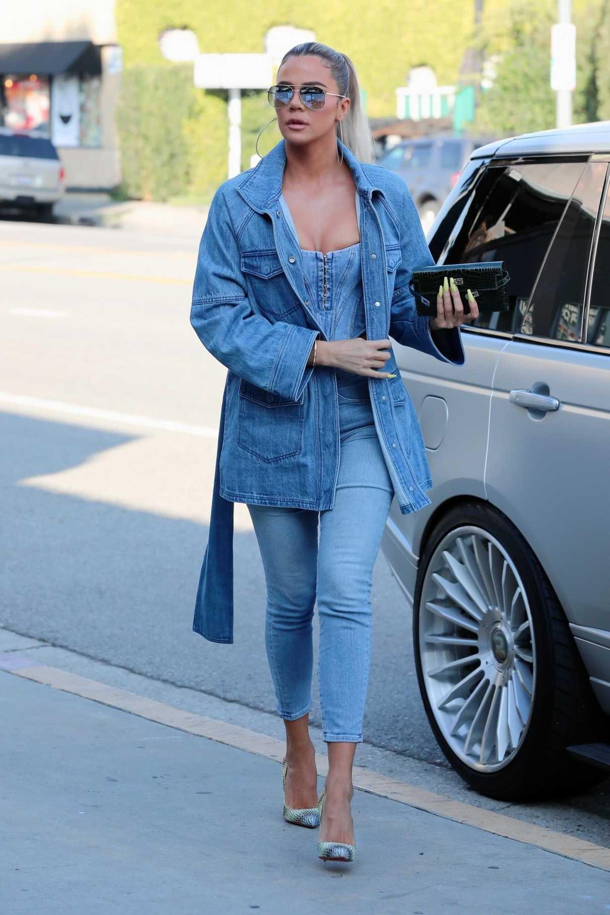 Khloe Kardashian in a Blue Denim Jacket