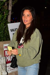 Olivia Munn in an Green Sweatshirt