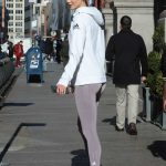 Karlie Kloss in a White Adidas Jogging Jacket