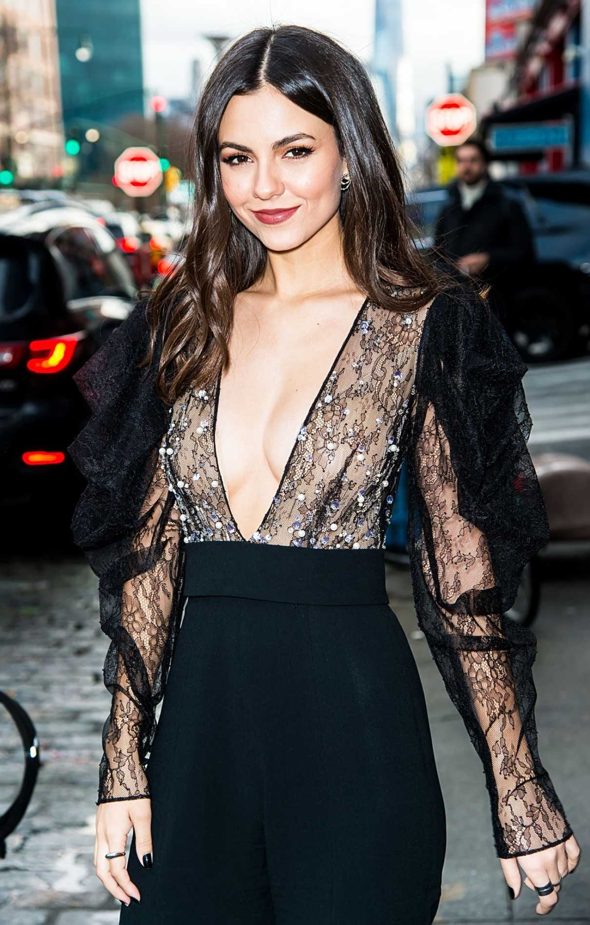 Victoria Justice in a Black See-Through Blouse Arrives at