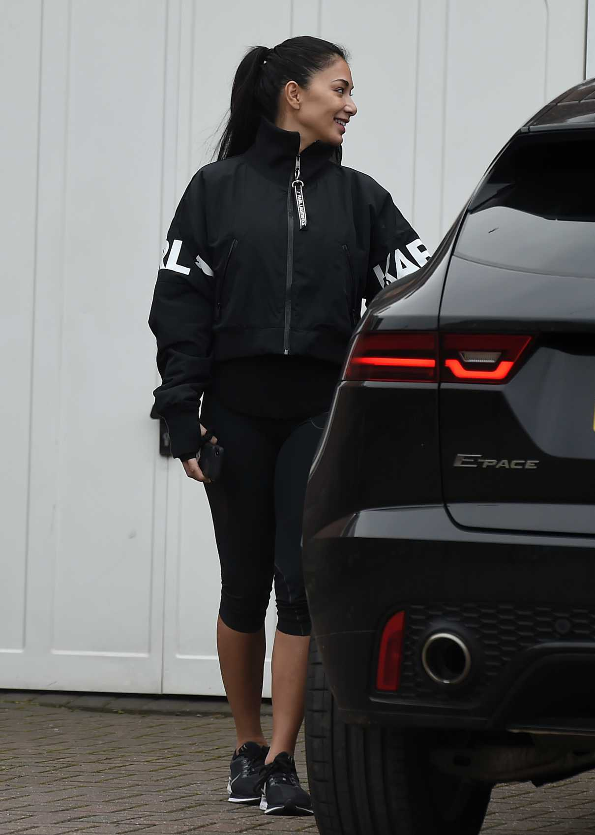 Nicole Scherzinger in a Black Sneakers
